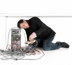 Man-fixing-computer-leads-300x268